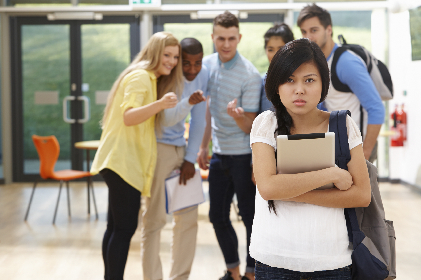 Female Student Being Bullied By Classmates